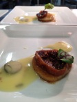 Pan seared scallop with caper butter and a candied fig