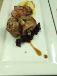 Roasted duck breast, stuffed and roasted duck leg (Farro, rabe, garlic,) with polenta and a cherry and olive tapenade