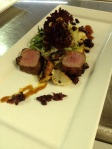 Pork Tenderloin with creamy polenta, candied pine nuts, and a cherry and olive tapenade