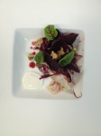 Beet salad, proscuitto, horseradish crema and a walnut vinaigrette