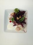 Beet salad, proscuitto, horseradish crema and a walnut vinaigrette