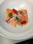 Salmon crudo with blood orange and horseradish