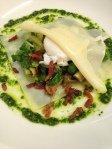 Open faced ravioli with spring vegetables and a poached quail egg
