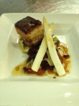 Crisp pork belly with poached white asparagus and a chicory salad tossed in a bacon vinaigrette