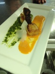 Pan seared scallops with arugula pesto and tomato coulis