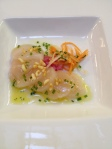 Scallop ceviche with crispy rice and pickled onions